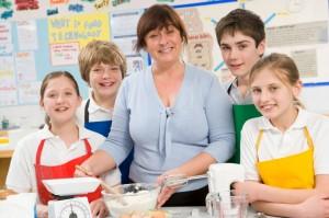 School children and teacher cooking